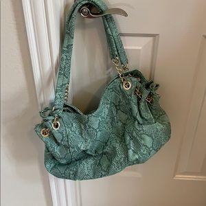 Charming Charlie's snakeskin hobo bag
